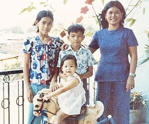 The children on a balcony in Saigon, perhaps taken the day they fled.