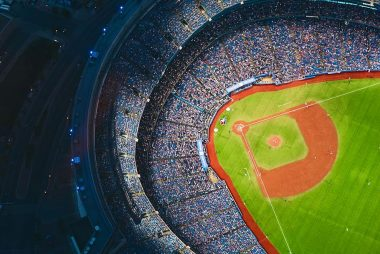 Aerial photograph of crowded baseball game at night.